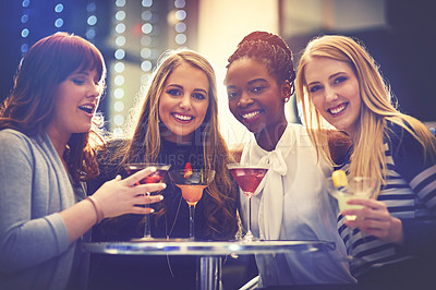 Buy stock photo Portrait of a group of happy friends enjoying cocktails in a nightclub