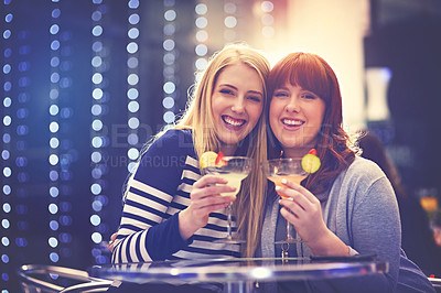 Buy stock photo Portrait of two friends enjoying cocktails in a nightclub