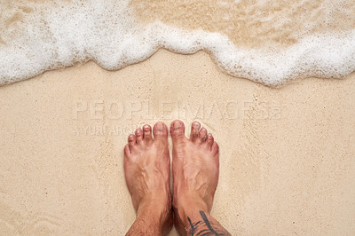 Buy stock photo High angle shot of a man's feet at the beach