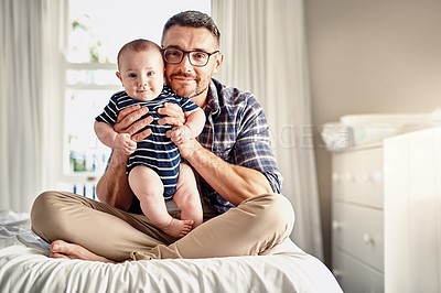 Buy stock photo Full length portrait of a father sitting on a bed at home with his son