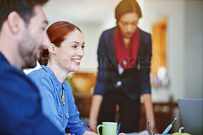 Buy stock photo Shot of a group of colleagues talking together while working in an office