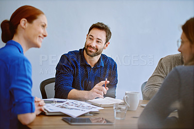 Buy stock photo Shot of a group of smiling colleagues talking together while working in an office