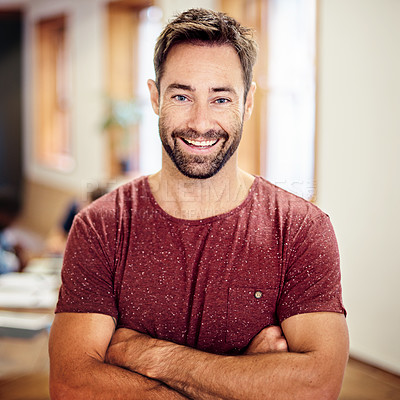 Buy stock photo Portrait of a smiling man standing with his arms crossed in an office