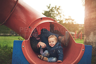 Buy stock photo Cropped shot of a father and his little son playing together at the park