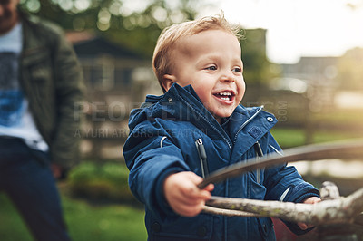 Buy stock photo Cropped shot of an adorable little boy playing on a farm tractor outside