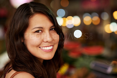 Buy stock photo Cropped portrait of a young female tourist standing inside a grocery store