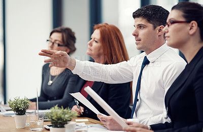 Buy stock photo Cropped shot of a panel of businesspeople giving feedback during a presentation in an office