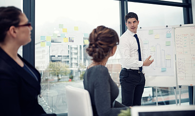Buy stock photo Cropped shot of a businessman giving a presentation to his colleagues in an office