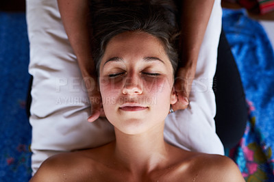 Buy stock photo High angle shot of a young woman getting a relaxing massage at the spa