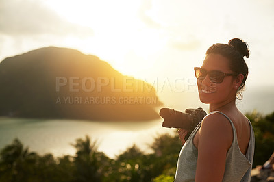 Buy stock photo Portrait of a happy young woman photographing a tropical view while on holiday