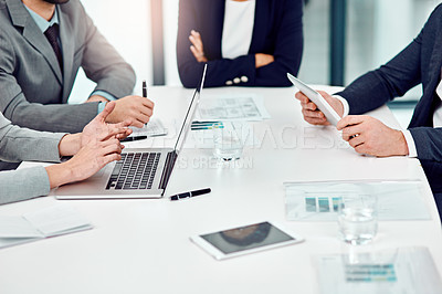 Buy stock photo Shot of a group of unrecognizable businesspeople meeting in the boardroom