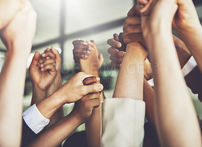 Buy stock photo Cropped shot of a group of businesspeople holding hands