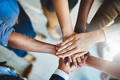 Buy stock photo Cropped shot of a group of businesspeople piling their hands on top of each other