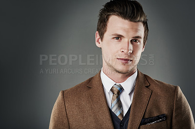 Buy stock photo Cropped shot of a young businessman posing against a grey background