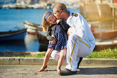 Buy stock photo Portrait of a father in a navy uniform posing with his little girl on the dock