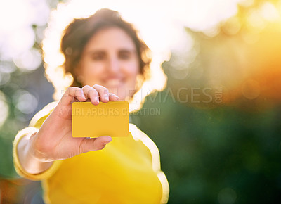 Buy stock photo Shot of an unrecognizable young woman holding a credit card
