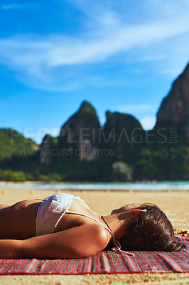 Buy stock photo Shot of a beautiful young woman relaxing on the beach