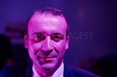 Buy stock photo Portrait of a shady businessman sitting in a seedy Thai nightclub