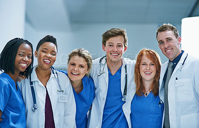 Buy stock photo Portrait of a team of confident young doctors working in a hospital
