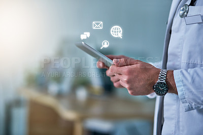 Buy stock photo Cropped shot of a doctor receiving notifications on a digital tablet