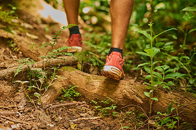 Buy stock photo Cropped shot of an unidentifiable man's feet as he hikes through the jungle