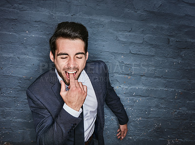 Buy stock photo Shit of a business man sticking his finger down his throat against a grey wall