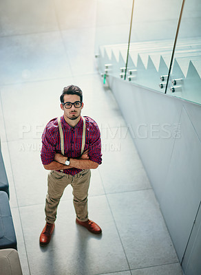 Buy stock photo Portrait of a handsome young designer standing with his arms folded in the office