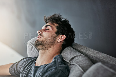 Buy stock photo Cropped shot of a beaten and bruised young man sleeping on the sofa