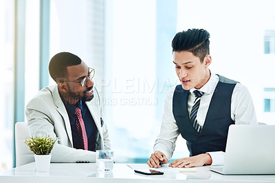 Buy stock photo Cropped shot of two young businessmen working together in the office