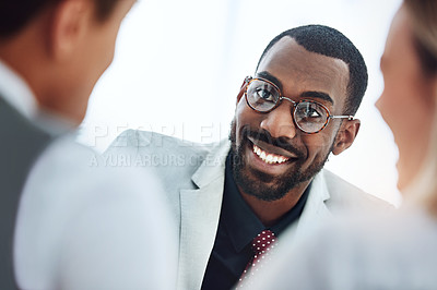 Buy stock photo Cropped shot of a young financial advisor meeting with his clients
