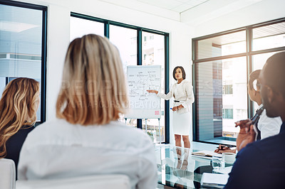 Buy stock photo Cropped shot of a young businesswoman giving a presentation in the boardroom