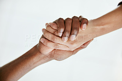 Buy stock photo Cropped shot of two people shaking hands