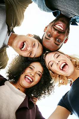 Buy stock photo Portrait of a group of happy people huddled together in solidarity