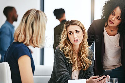 Buy stock photo Shot of a sad young woman being comforted by her colleagues during a meeting at work
