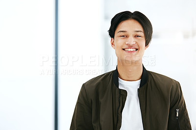 Buy stock photo Portrait of a confident young man working in a modern office