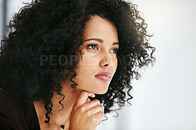 Buy stock photo Shot of a young woman looking away thoughtfully at work