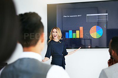 Buy stock photo Shot of a businesswoman giving a presentation to her colleagues at work