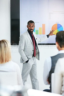Buy stock photo Shot of a businessman giving a presentation to his colleagues at work