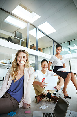 Buy stock photo Portrait of a group of colleagues having a brainstorming session in a modern office