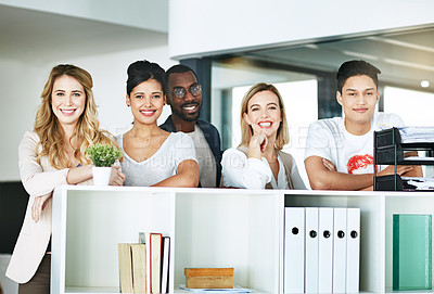 Buy stock photo Portrait of a group of happy colleagues standing together in a modern office