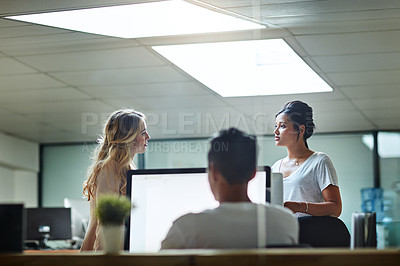 Buy stock photo Shot of two colleagues having a discussion at work