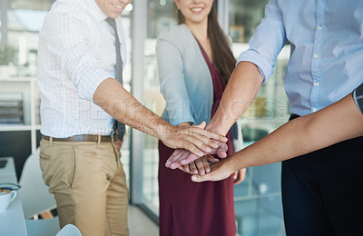 Buy stock photo Shot of a group of colleagues joining their hands together in solidarity