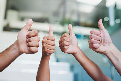 Buy stock photo Cropped shot of a group of hands showing thumbs up in an office