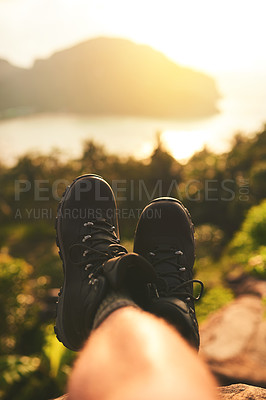 Buy stock photo Point of view shot of an unidentifiable tourist's feet as he admires an island view