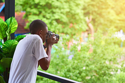 Buy stock photo Shot of an unidentifiable tourist taking a picture from his balcony