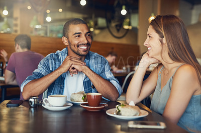 Buy stock photo Cropped shot of a young couple on a date in a cafe