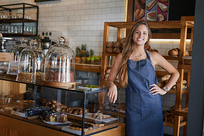 Buy stock photo Portrait of a young business owner standing in her bakery