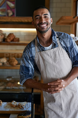 Buy stock photo Portrait of a young business owner standing in his bakery