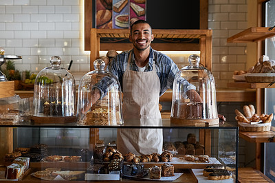 Buy stock photo Portrait of a young business owner standing behind the counter of his bakery