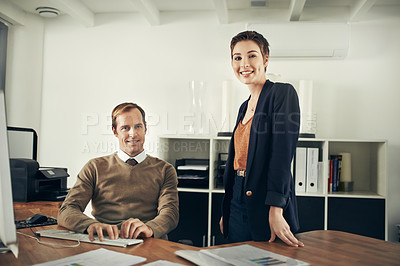 Buy stock photo Portrait of two colleagues working together in an office